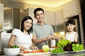 stock photo of daddy  - Asian Family spending time together in the kitchen - JPG