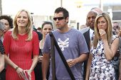 LOS ANGELES, CA - FEB 22: (R-L) Jennifer Aniston; Adam Sandler; Malin Akerman at ceremony where Jenn