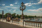 People On Elegant Bridge On The Seine River In Paris poster