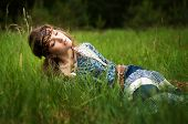 Hippie girl lies in the grass