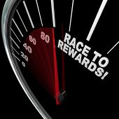 A red needle racing on a speedometer to the words Race to Rewards to illustrate the accumulation of customer loyalty points in a reward program for buyers