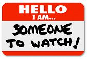 A namtag sticker with the words Hello I Am Someone to Watch to single out a special person or job ca
