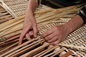 Female Hands Manually Mastering Wicker Fabric 4
