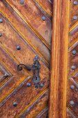 Ancient door handle on old door in Olomouc, Czech Republic.