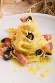 Tagliatelle With Bacon And Blacken To Olive Ones