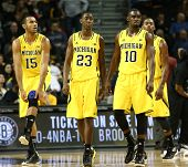 BROOKLYN-DEC 15: Michigan Wolverines Jon Horford (15), Caris LeVert (23), and Tim Hardaway Jr. (10)