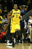 BROOKLYN-DEC 15: Michigan Wolverines forward Glenn Robinson III (1) reacts on the court against the