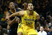 BROOKLYN-DEC 15: Michigan Wolverines forward Jordan Morgan (52) and West Virginia Mountaineers forwa