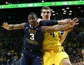 BROOKLYN-DEC 15: West Virginia Mountaineers guard Juwan Staten (3) and Michigan Wolverines forward M