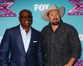 .LOS ANGELES - DEC 17:  L.A. Reid, Tate Stevens at the 'X Factor' Season Finale Press Conference at