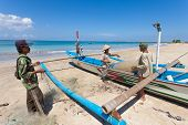 BALI - FEBRUARY 13. Fishermen cleaning nets on beach on February 13, 2012 in Bali, Indonesia. Fisher