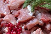 Raw Meat Background With Dill And Cowberries