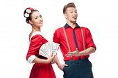 young retro couple holding money