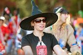 Woman In Witch Hat Walks In Halloween Parade