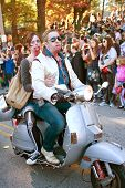 Zombie Couple Rides Scooter In Halloween Parade