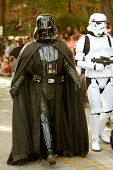 Darth Vader And Stormtrooper Walk In Halloween Parade