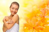 Young healthy woman on autumnal background