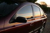 image of car-window  - sunset reflecting on the side of a very clean car - JPG