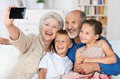 Grandparents And Grandchildren With A Camera