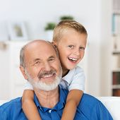 Laughing Grandfather With His Grandson