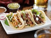 authentic mexican barbacoa, carnitas and chicken tacos