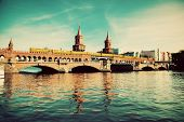 The Oberbaum Bridge, German Oberbaumbrucke and River Spree in Berlin, Germany. Retro, vintage versio