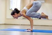 Pretty Young Woman Doing Yoga Exercise