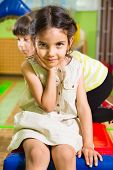 picture of daycare  - Portrait of little cute latin girl in daycare gym - JPG