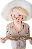 pic of safari hat  - Isolated female safari traveler holding a map - JPG
