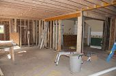 stock photo of home addition  - New construction addition being added to old home - JPG