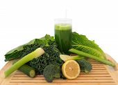 picture of leafy  - Glass of green vegetable juice with fresh vegetables on a cutting board over white - JPG