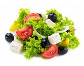 Salad. Greek Salad isolated on a White Background. Mediterranean Salad with Feta Cheese, Tomatoes and Olives