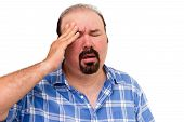 Middle-aged Man Experiencing A Headache