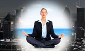 Business woman doing yoga. Relaxation.