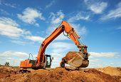 loader excavator machine doing earthmoving work at sand quarry