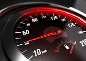 stock photo of low-light  - Close up of a car speedometer with the needle pointing 30 Km h blur effect conceptual image for safe driving concept - JPG