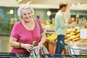 woman during shopping at fruit or vegetable supermarket store shop