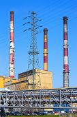 image of chp  - Power station with chimneys on blue sky background - JPG
