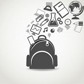 Education icons flowing into open school bag