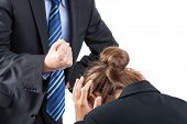 stock photo of white collar crime  - Boss is clamping his fist above frightened worker - JPG