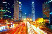 image of colorful building  - Colorful city night with lights of cars motion blurred in hong kong - JPG