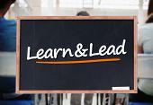 Learn and lead written on blackboard in a classroom