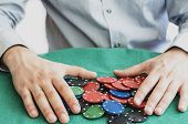 hands holding poker chips