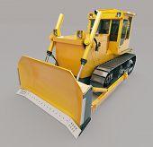 Heavy crawler bulldozer on a gray background