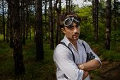 stock photo of wolfman  - Portrait of man with motorcycle goggles and gloves - JPG