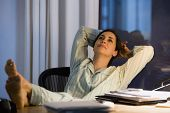 pic of pajamas  - Portrait of businesswoman sitting  in pajamas at desk - JPG