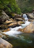 foto of backwoods  - Motion Blur Waterfalls Nature Landscape in Blue Ridge Mountains with green trees rusty natural orange rocks and flowing water - JPG