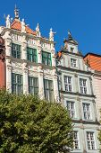 stock photo of tenement  - Facades of ancient tenements in the old town in Gdansk Poland - JPG