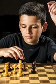 stock photo of 11 year old  - An 11 year old playing a game a chess.