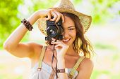 happy young girl with camera outdoors